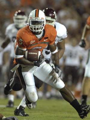 MIAMI, FL - SEPTEMBER 20: Running back Javarris James #5 of  the University of Miami Hurricanes rushes upfield against the Texas A&M Aggies at the Orange Bowl on September 20, 2007 in Miami, Florida.  Miami won 31-17.  (Photo by Al Messerschmidt/Getty Ima