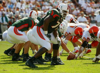 MIAMI - NOVEMBER 15:  Offensive lineman Carlos Joseph #76 of the University of Miami Hurricanes waits for the snap during the game against the Syracuse University Orangemen at the Orange Bowl on November 15, 2003 in Miami, Florida. Miami defeated Syracuse