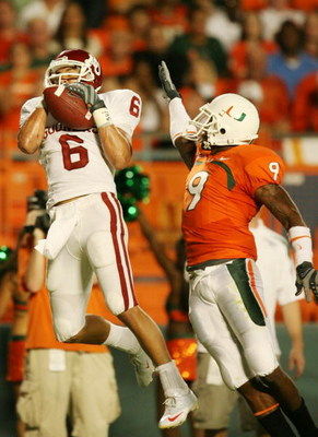 MIAMI GARDENS, FL - OCTOBER 3:  Wide receiver Cameron Kenney #6 of the Oklahoma Sooners catches a pass for a 16-yard touchdown in front of Sam Shields #9 of the Miami Hurricanes during the first quarter of the game on October 3, 2009 at Landshark Stadium