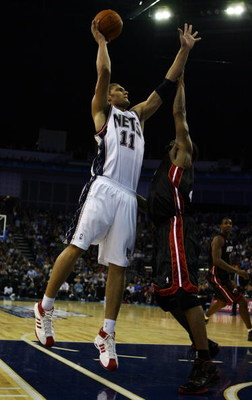 LONDON - OCTOBER 12:  Brook Lopez (#11) of New Jersey Nets attempts the shot over Udonis Haslem (#40) of the Miami Heat during the NBA preseason game as part of the 2008 NBA Europe Live Tour between New Jersey Nets and Miami Heat at the O2 Arena on Octobe