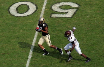 WEST LAFAYETTE, IN - SEPTEMBER 20: Wide receiver Aaron Valentin #17 of the Purdue Boilermakers makes a pass reception against LaVarus Williams #24 of the Central Michigan Chippewas at Ross-Ade Stadium on September 20, 2008 in West Lafayette, Indiana.  (Ph