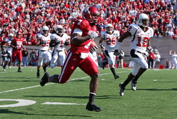BLOOMINGTON, IN - NOVEMBER 3:  Ray Fisher #7 of the Indiana Hoosiers runs for a touchdown after a reception against the Ball State Cardinals during the game at Memorial Stadium November 3, 2007 in Bloomington, Indiana.  (Photo by Andy Lyons/Getty Images)