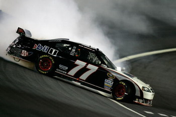 CONCORD, NC - OCTOBER 17:  Sam Hornish Jr., driver of the #77 Mobile 1 Dodge, loses control of his car during the NASCAR Sprint Cup Series NASCAR Banking 500 at Lowe's Motor Speedway on October 17, 2009 in Concord, North Carolina.  (Photo by Jason Smith/G