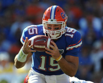GAINESVILLE, FL - OCTOBER 17: Quarterback Tim Tebow #15 of the Florida Gators bobbles a snap against the University of Arkansas Razorbacks October 17, 2009 at Ben Hill Griffin Stadium in Gainesville, Florida.  (Photo by Al Messerschmidt/Getty Images)