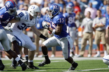 LAWRENCE, KS - SEPTEMBER 19:  Cornerback Daymond Patterson #15 of the Kansas Jayhawks carries the ball during the game against the Duke Blue Devils on Kivisto Field at Memorial Stadium on September 19, 2009 in Lawrence, Kansas. (Photo by Jamie Squire/Gett