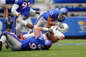 LAWRENCE, KS - NOVEMBER 15:  James Holt #12 and Caleb Blakesley #94 of the Kansas Jayhawks tackle Foswhitt Whittaker #28 of the Texas Longhorns on November 15, 2008 at Memorial Stadium in Lawrence, Kansas.  Texas defeated Kansas 35-7. (Photo by G. Newman