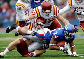 LAWRENCE, KS - OCTOBER 10:  Bradley McDougald #24 of the Kansas Jayhawks is tackled by Michael O'Connell #37 of the Iowa State Cyclones during the game on October 10, 2009 at Memorial Stadium in Lawrence, Kansas.  (Photo by Jamie Squire/Getty Images)