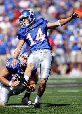 LAWRENCE, KS - SEPTEMBER 19:  Jacob Branstetter #14 of the Kansas Jayhawks kicks an extra point during the game against the Duke Blue Devils on Kivisto Field at Memorial Stadium on September 19, 2009 in Lawrence, Kansas.  (Photo by Jamie Squire/Getty Imag