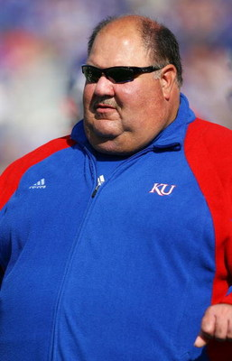 LAWRENCE, KS - SEPTEMBER 26:  Head coach Mark Mangino of the Kansas Jayhawks watches during warm-ups just prior to the start of the game against the Southern Mississippi Golden Eagles on September 26, 2009 at Memorial Stadium in Lawrence, Kansas.  (Photo