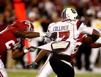 TUSCALOOSA - OCTOBER 17:  Return man Chris Culliver #17 of the South Carolina Gamecocks is tackled by special teams defender Terry Grant #29 of the Alabama Crimson Tide at Bryant-Denny Stadium on October 17, 2009 in Tuscaloosa, Alabama. The Crimson Tide b