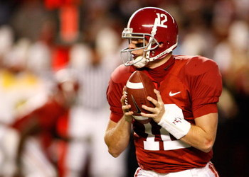 TUSCALOOSA - OCTOBER 17:  Quarterback Greg McElroy #12 of the Alabama Crimson Tide looks to hand off the ball during the game against the South Carolina Gamecocks at Bryant-Denny Stadium on October 17, 2009 in Tuscaloosa, Alabama.  The Crimson Tide beat t