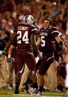 COLUMBIA, SC - SEPTEMBER 24:  Stephen Garcia #5 of the South Carolina Gamecocks celebrates with teammate Darian Stewart #24 after a 16-10 vicotry over the Ole Miss Rebels during their game at Williams-Brice Stadium on September 24, 2009 in Columbia, South