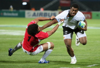 DUBAI, UNITED ARAB EMIRATES - MARCH 05:  Napolinoi Nalaga of Fiji is tackled during the Pool B match between Fiji and Georgia at the IRB Rugby World Cup Sevens 2009 at The Sevens stadium on March 5, 2009 in Dubai, UAE.  (Photo by Warren Little/Getty Image