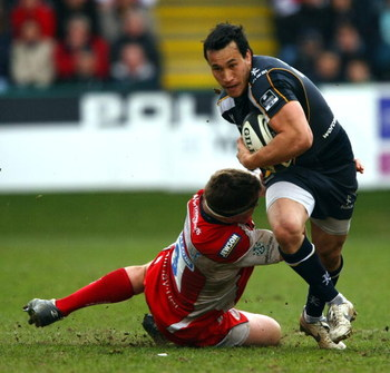 WORCESTER, UNITED KINGDOM - MARCH 22:  Rico Gear of Worcester avoids a tackle during the Guinness Premiership game between Worcester Warriors and Gloucester at Sixways Stadium on March 22, 2009 , Worcester, England.  (Photo by John Gichigi/Getty Images)