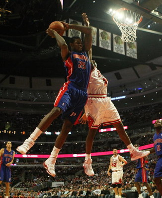 CHICAGO - MARCH 24: Amir Johnson #25 of the Detroit Pistons grabs a rebound over Ben Gordon #7 of the Chicago Bulls on March 24, 2009 at the United Center in Chicago, Illinois. The Bulls defeated the Pistons 99-91. NOTE TO USER: User expressly acknowledge