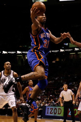 EAST RUTHERFORD, NJ - OCTOBER 20:  Wilson Chandler #21 of the New York Knicks goes up for a shot against the New Jersey Nets during the first half of a pre-season game on October 20, 2008 at the IZOD Center in East Rutherford, New Jersey. NOTE TO USER: Us