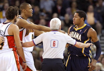 OAKLAND, CA - JANUARY 11: Danny Granger #33 of the Indiana Pacers argues with Marco Belinelli #18 and Anthony Randolph #4 of the Golden State Warriors during an NBA game on January 11, 2009 at Oracle Arena in Oakland, California. Granger and Belinelli wer