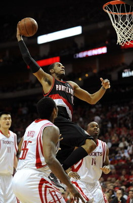 HOUSTON - APRIL 24:  Forward LaMarcus Aldridge #12 of the Portland Trail Blazers makes the slam dunk against Ron Artest #96 of the Houston Rockets in Game Three of the Western Conference Quarterfinals during the 2009 NBA Playoffs at Toyota Center on April