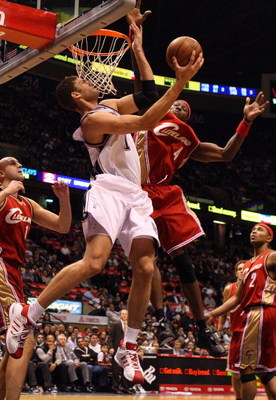 EAST RUTHERFORD, NJ - NOVEMBER 18:  Brook Lopez #11 of the New Jersey Nets attempts a layup against Ben Wallace #4 of the Cleveland Cavaliers at the Izod Center on November 18, 2008 in East Rutherford, New Jersey. NOTE TO USER: User expressly acknowledges