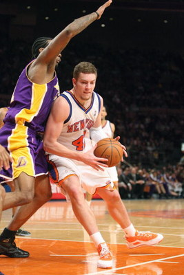 NEW YORK - FEBRUARY 2:  David Lee #42 of the New York Knicks drives the ball against the Los Angeles Lakers on February 2, 2009 at Madison Square Garden in New York City. NOTE TO USER: User expressly acknowledges and agrees that, by downloading and or usi