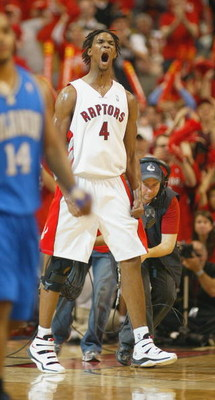 TORONTO, ON - APRIL 26:  Chris Bosh #4 of the Toronto Raptors jubilates after hitting a 3 ball against the Orlando Magic in Game Four of the Eastern Conference Quarterfinals at the Air Canada Centre April 26, 2008 in Toronto, Ontario. The Magic defeated t