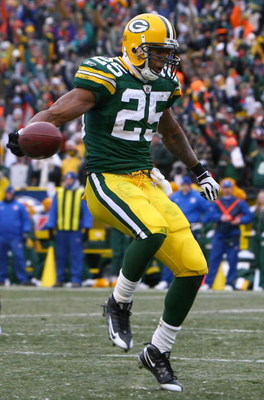 GREEN BAY, WI - DECEMBER 07:  Running back Ryan Grant #25 of the Green Bay Packers runs into the endzone for a touchdown in the fourth quarter against the Houston Texans at Lambeau Field on December 7, 2008 in Green Bay, Wisconsin. The Texans defeated the