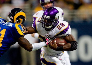 ST. LOUIS - OCTOBER 11:  Adrian Peterson #28 of the Minnesota Vikings runs for yardage during their NFL game against the St. Louis Rams at the Edward Jones Dome on October 11, 2009 in St. Louis, Missouri. The Vikings defeated the Rams 38-10. (Photo by Dil
