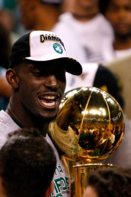 BOSTON - JUNE 17:  Kevin Garnett #5 of the Boston Celtics holds the Larry O'Brien trophy after Game Six of the 2008 NBA Finals against the Los Angeles Lakers on June 17, 2008 at TD Banknorth Garden in Boston, Massachusetts. The Celtics defeated the Lakers