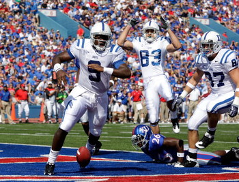 LAWRENCE, KS - SEPTEMBER 19:  Quarterback Thaddeus Lewis #9 of the Duke Blue Devils crosses the goal line for a touchdown during the 1st half of the game against the Kansas Jayhawks at Kivisto Field at Memorial Stadium on September 19, 2009 in Lawrence, K