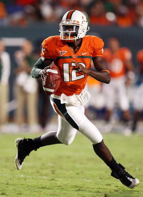 FORT LAUDERDALE, FL - SEPTEMBER 17: Quarterback Jacory Harris #12 of the Miami Hurricanes scrambles against the Georgia Tech Yellow Jackets at Land Shark Stadium on September 17, 2009 in Fort Lauderdale, Florida.  (Photo by Doug Benc/Getty Images)
