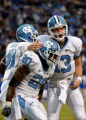 DURHAM, NC - NOVEMBER 29:  Quarterback T.J. Yates #13 of the North Carolina Tar Heels celebrates with running back Shaun Draughn #20 after Draughn's touchdown against the Duke Blue Devils during the game at Wallace Wade Stadium on November 29, 2008 in Dur