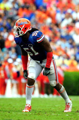GAINESVILLE, FL - SEPTEMBER 12:  Brandon Spikes #51 of the Florida Gators lines up during the game against the Troy Trojans at Ben Hill Griffin Stadium on September 12, 2009 in Gainesville, Florida.  (Photo by Sam Greenwood/Getty Images)