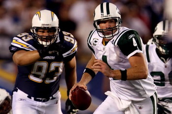 SAN DIEGO - SEPTEMBER 22:  Brett Favre #4 of the New York Jets looks to pass the ball as he is chased by Luis Castillo #93 of the San Diego Chargers on September 22, 2008 at Qualcomm Stadium in San Diego, California.  (Photo by Stephen Dunn/Getty Images)