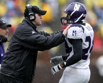 ANN ARBOR, MI - OCTOBER 28:  Head coach Pat Fitzgerald of the Northwestern Wildcats talks with Kevin Mitchell #24 during a game against the Michigan Wolverines on October 28, 2006 at Michigan Stadium in Ann Arbor, Michigan. Michigan defeated Northwestern