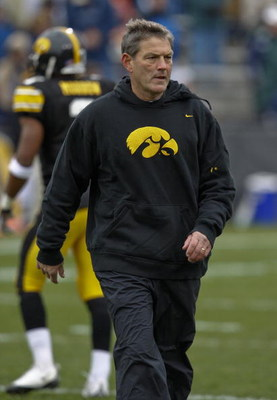 IOWA CITY, IOWA - NOVEMBER 8: Head Coach Kirk Ferentz of the Iowa Hawkeyes runs his team through warm up drills before taking on the  Penn State Nittany Lions at Kinnick Stadium on November 8, 2008 in Iowa City, Iowa. Iowa defeated Penn State  24-23. (Pho