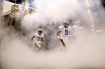 NEW ORLEANS - OCTOBER 18:  Drew Brees #9 of the New Orleans Saints runs onto the field during player introductions before playing the New York Giants at the Louisiana Superdome on October 18, 2009 in New Orleans, Louisiana.  (Photo by Chris Graythen/Getty