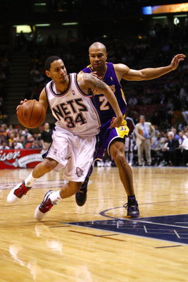 EAST RUTHERFORD, NJ - MARCH 27:  Devin Harris #34 of the New Jersey Nets drives against Derek Fisher #2 of the Los Angeles Lakers during the game on March 27, 2009 at the Izod Center in East Rutherford, New Jersey. NOTE TO USER: User expressly acknowledge