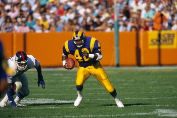 ANAHEIM, CA - NOVEMBER 12: Running back Greg Bell #42 of the Los Angeles Rams finds room to run with the ball against the New York Giants at Anaheim Stadium on November 12, 1989 in Anaheim, California. The Rams won 31-10. (Photo by George Rose/Getty Image