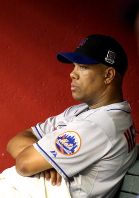 PHOENIX - AUGUST 11:  Starting pitcher Livan Hernandez #61 of the New York Mets reacts in the dugout after being removed from the major league baseball game against the Arizona Diamondbacks at Chase Field on August 11, 2009 in Phoenix, Arizona.  (Photo by