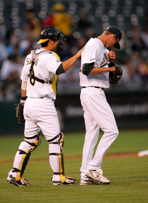 OAKLAND, CA - SEPTEMBER 04:  Catcher Kurt Suzuki #8 of the Oakland Athletics consoles pitcher Clayton Mortensen #62 in the second inning of their game against the Seattle Mariners at the Oakland Coliseum on September 4, 2009 in Oakland, California.  (Phot