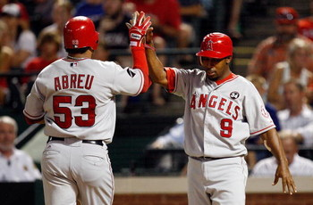 ARLINGTON, TX - JULY 1:  Bobby Abreu #53 and Chone Figgins #9 of the Los Angeles Angels of Anaheim celebrate after scoring against the Texas Rangers in the seventh inning at Rangers Ballpark July 1, 2009 in Arlington, Texas.  (Photo by Ronald Martinez/Get