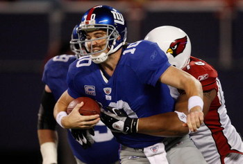 EAST RUTHERFORD, NJ - OCTOBER 25: Eli Manning #10 of the New York Giants is sacked in the second half by Alan Branch #78 of the Arizona Cardinals on October 25, 2009 at Giants Stadium in East Rutherford, New Jersey. (Photo by Jared Wickerham/Getty Images)
