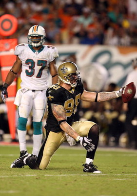 MIAMI - OCTOBER 25:  Tight end Jeremy Shockey #88 of the New Orleans Saints celebrates after making a first down reception over safety Yeremiah Bell #37 of the Miami Dolphins at Land Shark Stadium on October 25, 2009 in Miami, Florida. The Saints defeated