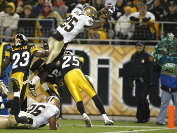 PITTSBURGH - NOVEMBER 12:  Reggie Bush #25 of the New Orleans Saints jumps for the end zone to score a touchdown over Ryan Clark #25 of the Pittsburgh Steelers  on November 12, 2006 at Heinz Field in Pittsburgh, Pennsylvania.  (Photo by Rick Stewart/Getty