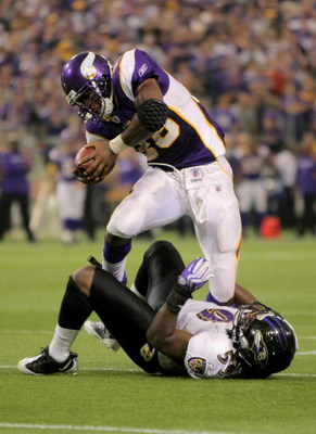 MINNEAPOLIS - OCTOBER 18:  Running back Adrian Peterson #28 of the Minnesota Vikings rushes and is tackled by Dannell Ellerbe #59 of the Baltimore Ravens during NFL action at Hubert H. Humphrey Metrodome on October 18, 2009 in Minneapolis, Minnesota. The