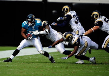 JACKSONVILLE, FL - OCTOBER 18:  Mike Thomas #80 of the Jacksonville Jaguars is tackled by Quincy Butler #36 of the St. Louis Rams during the game at Jacksonville Municipal Stadium on October 18, 2009 in Jacksonville, Florida.  (Photo by Sam Greenwood/Gett
