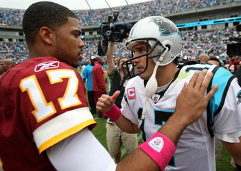 CHARLOTTE, NC - OCTOBER 11:  Jason Campbell #17 of Washington Redskins talks to Jake Delhomme #17 of the Carolina Panthers after their game at Bank of America Stadium on October 11, 2009 in Charlotte, North Carolina.  (Photo by Streeter Lecka/Getty Images