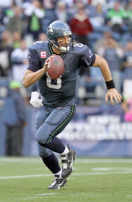 SEATTLE - OCTOBER 18:  Quarterback Matt Hasselbeck #8 of the Seattle Seahawks moves to pass the ball during the game against the Arizona Cardinals on October 18, 2009 at Qwest Field in Seattle, Washington. (Photo by Otto Greule Jr/Getty Images)
