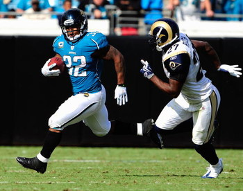 JACKSONVILLE, FL - OCTOBER 18:  Maurice Jones-Drew #32 of the Jacksonville Jaguars is chased by David Roach #27 of the St. Louis Rams during the game at Jacksonville Municipal Stadium on October 18, 2009 in Jacksonville, Florida.  (Photo by Sam Greenwood/