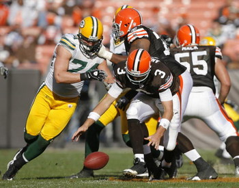 CLEVELAND, OH - OCTOBER 25:  Derek Anderson #3 of the Cleveland Browns fights for a fumble with Aaron Kampman #74 the Green Bay Packers at Cleveland Browns at Cleveland Browns Stadium on October 25, 2009 in Cleveland, Ohio.  (Photo by Matt Sullivan/Getty